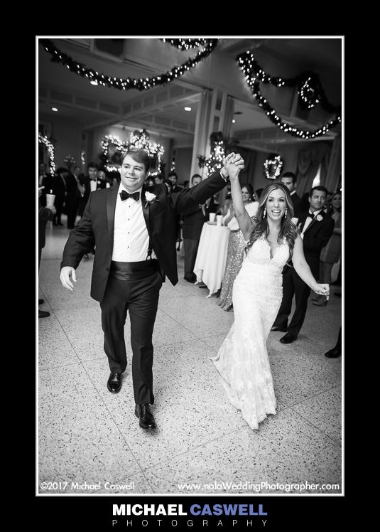 Bride and groom enter reception at Boudreaux