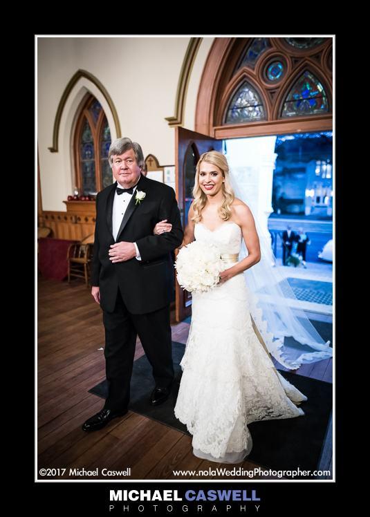 Bride and father walk into church